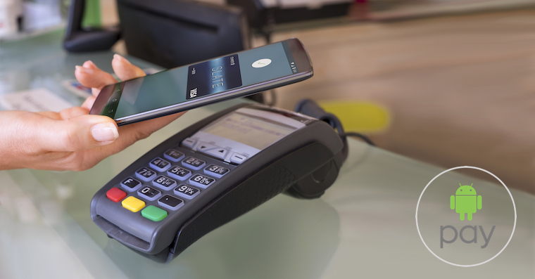 Woman's hand using contactless smartphone to pay at beauty salon